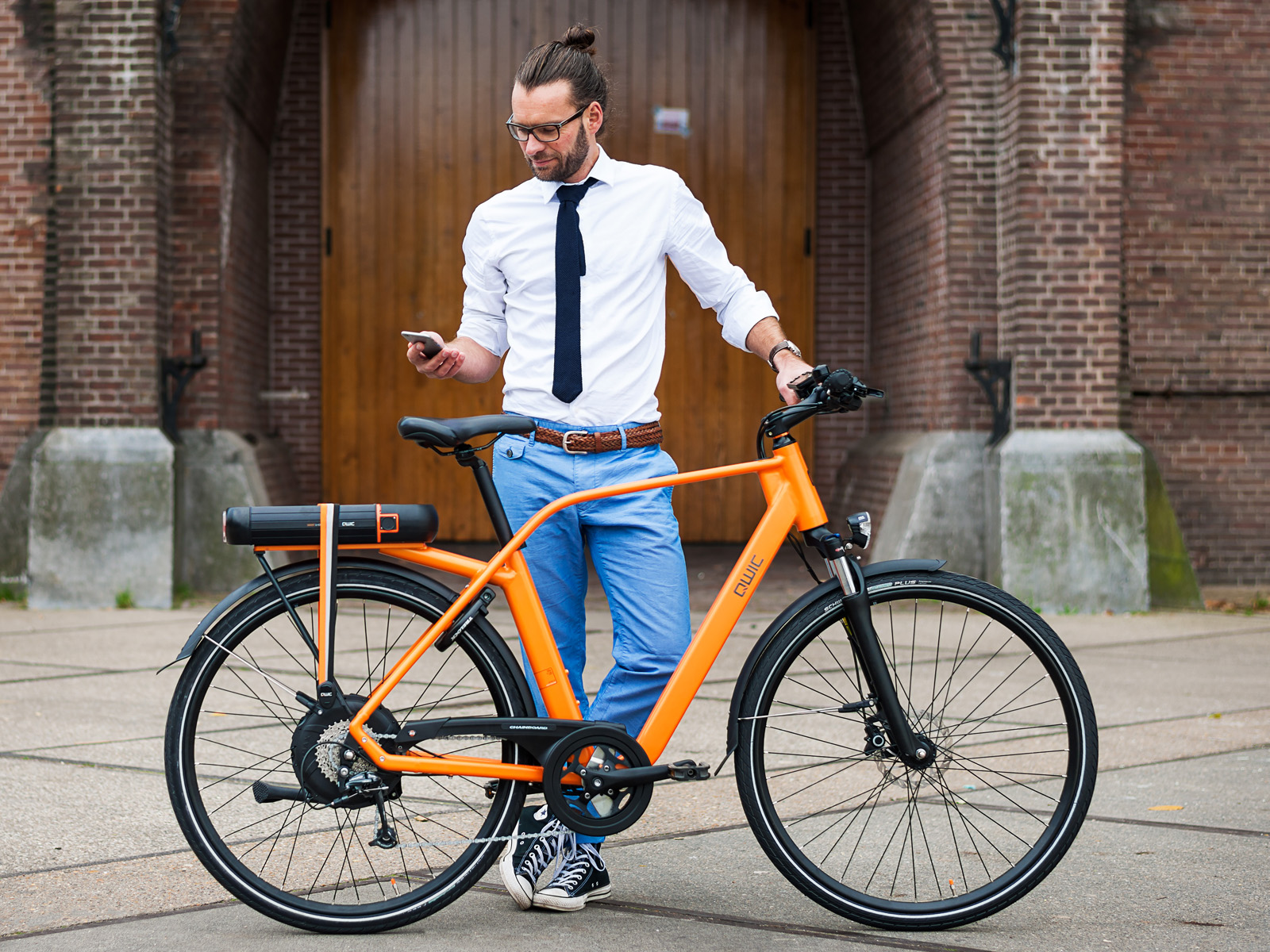 man met fiets qwic